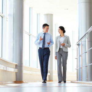 Business man and woman walking and talking